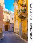 Small photo of View of a narrow street in Marsala, Sicily, Italy