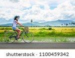woman traveler enjoying for ... | Shutterstock . vector #1100459342