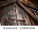 old wooden gate closed on a... | Shutterstock . vector #1100461658