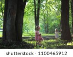 mom with two daughters twins... | Shutterstock . vector #1100465912