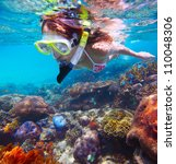 young woman snorkeling in a... | Shutterstock . vector #110048306