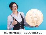 happy young girl holding golden ...   Shutterstock . vector #1100486522