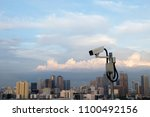 cctv with cityscape background | Shutterstock . vector #1100492156