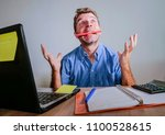 young crazy stressed and... | Shutterstock . vector #1100528615