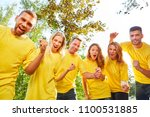 happy team celebrates success... | Shutterstock . vector #1100531885