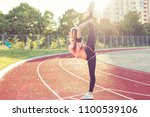 young woman doing stretching.... | Shutterstock . vector #1100539106