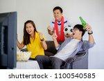 people watch soccer. asian... | Shutterstock . vector #1100540585