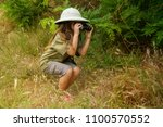 a little girl in a tropical... | Shutterstock . vector #1100570552