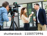 professional cameraman and... | Shutterstock . vector #1100573996