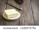 butter on dark wooden... | Shutterstock . vector #1100575796