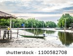 the boat parked along the... | Shutterstock . vector #1100582708