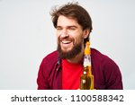man smiling holding a... | Shutterstock . vector #1100588342