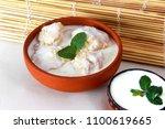 dahi bara in desi bowl  indian...   Shutterstock . vector #1100619665