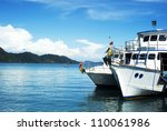 Ships waiting for tourists on Koh Chang island, Thailand - stock photo