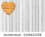 wooden heart on white wooden... | Shutterstock . vector #1100621528