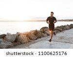 portrait of a healthy sportsman ... | Shutterstock . vector #1100625176