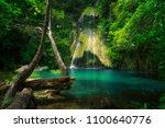 pha nam yod waterfall in... | Shutterstock . vector #1100640776