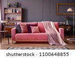 Front view of a pink sofa with...