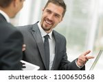 closeup.business partners... | Shutterstock . vector #1100650568
