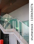 Small photo of Staircase and handrail to the upper floor.