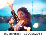 happy woman with fairy light... | Shutterstock . vector #1100662055