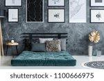 gold leaf near green mattress... | Shutterstock . vector #1100666975