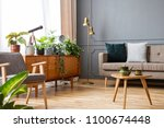 wooden table in vintage living... | Shutterstock . vector #1100674448