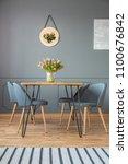 fresh tulips in glass vase... | Shutterstock . vector #1100676842