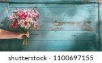 woman hand holding bouquet of... | Shutterstock . vector #1100697155