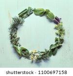 various herb leaves round frame ... | Shutterstock . vector #1100697158