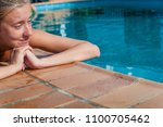 woman sunbathing at swimming... | Shutterstock . vector #1100705462
