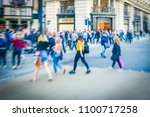 motion blurred crowds of...   Shutterstock . vector #1100717258