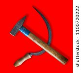Small photo of Old real sickle and hammer lying as the soviet communist symbol isolated on red background with shadows