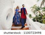 gorgeous hindu groom in blue... | Shutterstock . vector #1100723498