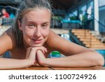 woman sunbathing at swimming... | Shutterstock . vector #1100724926