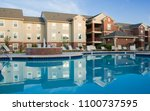apartment complex with... | Shutterstock . vector #1100737595
