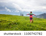 children hiking in alps... | Shutterstock . vector #1100742782