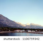 Small photo of Dawn over the mountains in beldibi turkey red sea