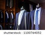 luxury suit in shop | Shutterstock . vector #1100764052