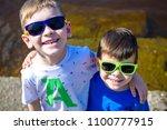portrait of happy kids on a... | Shutterstock . vector #1100777915