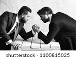 brokers arm wrestling in office | Shutterstock . vector #1100815025