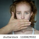 man covering mouth of young... | Shutterstock . vector #1100829032