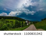 a path leading into a stormy... | Shutterstock . vector #1100831342