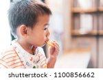 close up on asian little boy... | Shutterstock . vector #1100856662