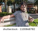 handsome young african american ... | Shutterstock . vector #1100868782