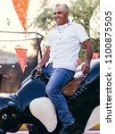 male on mechanical bull | Shutterstock . vector #1100875505