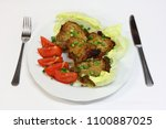 roasted pork chop with fresh... | Shutterstock . vector #1100887025