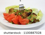 roasted pork chop with fresh... | Shutterstock . vector #1100887028
