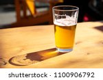 close up on a pint glass of... | Shutterstock . vector #1100906792