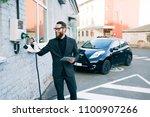a businessman charges an...   Shutterstock . vector #1100907266
